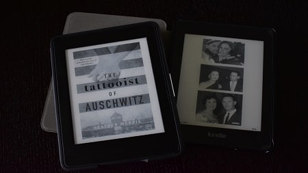 The ebook versions of The Tattooist of Auschwitz on two Kindles.